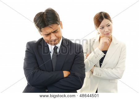 Dissatisfied businessman and businesswoman