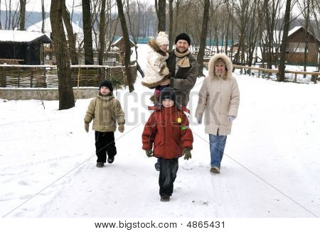 Happy Family Walk Togeather Outdoor In Winter
