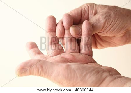 man tries to move sore finger