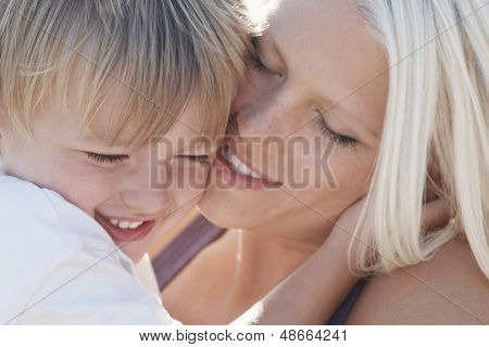 Closeup of playful young woman with son