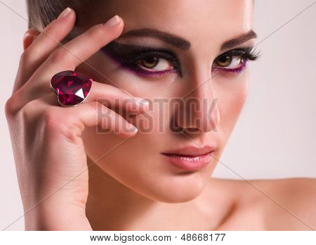 Fashionable woman with jewelry ring.