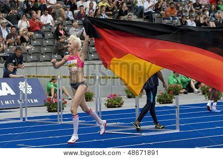 June 14 2009; Berlin Germany. Ariane FRIEDRICH (GER) celebrates to the home crowd after competing in the high jump at the DKB ISTAF 68 International Stadionfest Golden League Athletics competition.
