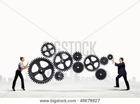 Businessman and businesswoman with cog wheel elements. Organization concept