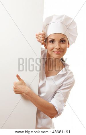 Chef woman with blank board in front of her , isolated