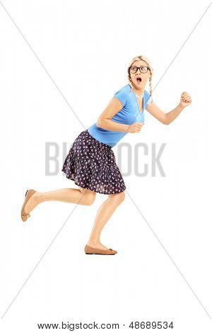 Full length portrait of a scared woman running away isolated on white background