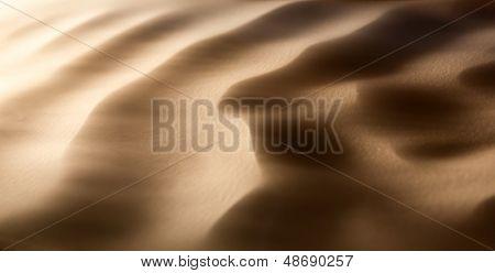 Sandstorm in desert -  dunes in the wind