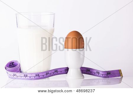 Glass Of Milk With Boiled Egg And Tape