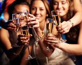 Group of partying girls clinking flutes with sparkling wine poster