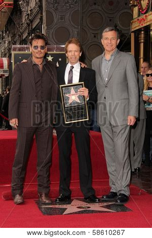 Johnny Depp, Bob Iger and Jerry Bruckheimer at the Jerry Bruckheimer Star on the Hollywood Walk of Fame ceremony, Hollywood, CA 06-24-13
