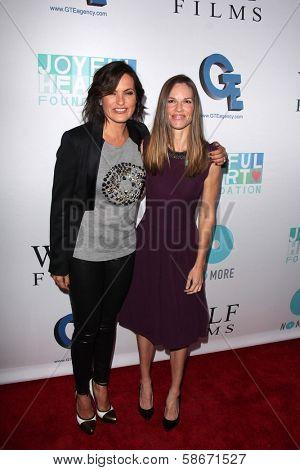 Mariska Hargitay and Hilary Swank at the Joyful Heart Foundation celebrates the No More PSA Launch, Milk Studios, Los Angeles, CA 09-26-13