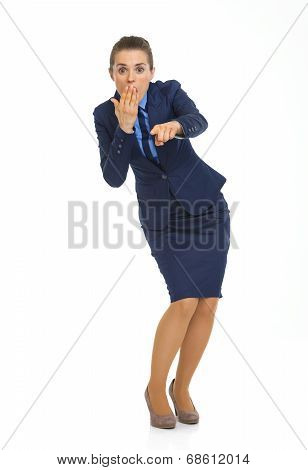 Full Length Portrait Of Surprised Business Woman Pointing In Cam