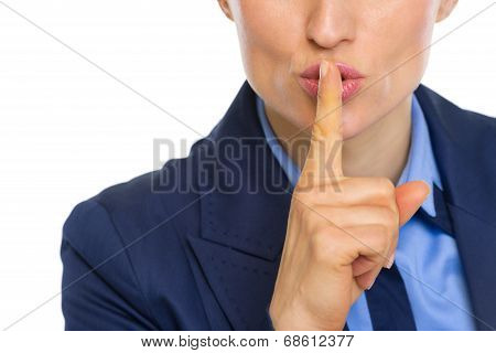 Closeup On Business Woman Showing Shh Gesture