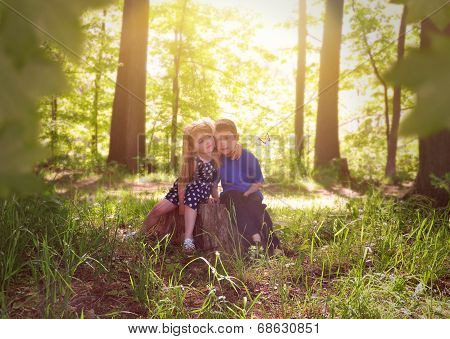 Children In Green Sunny Nature Woods