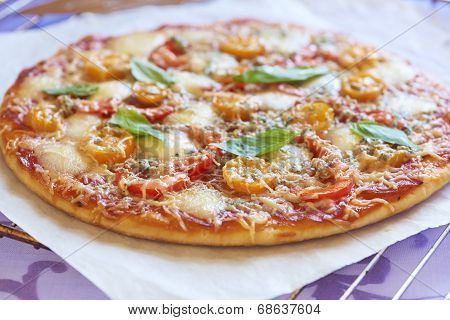 Pizza with pepperoni, tomatoes, pepper and mozzarella