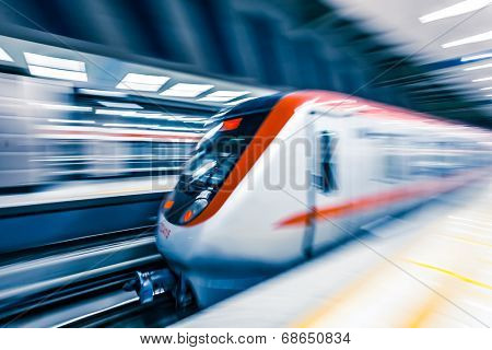Moving train in subway station