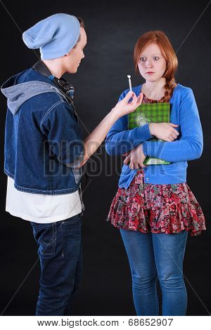 Teenager Giving Joint To Friend