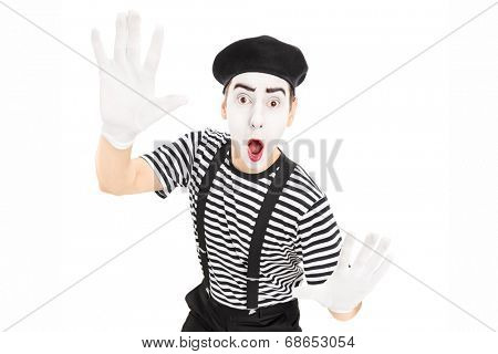 Male actor mimicking with hands isolated against white background