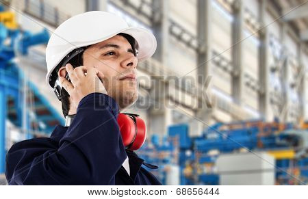 Portrait of an industrial worker in a factory poster