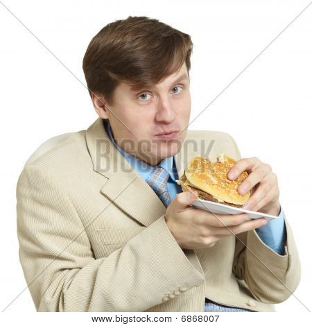 Funny Businessman Eats A Sandwich Isolated On A White