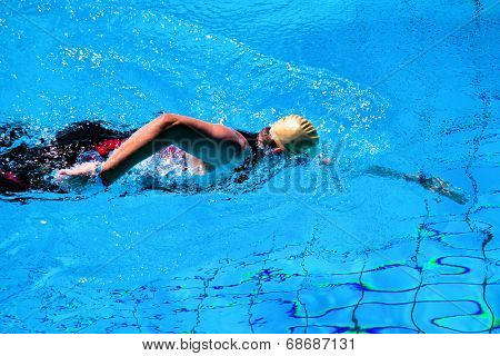 Swimming man in the pool during a triathlon in Germany
