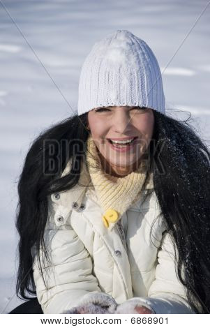 Happy Woman In Snow Portrait