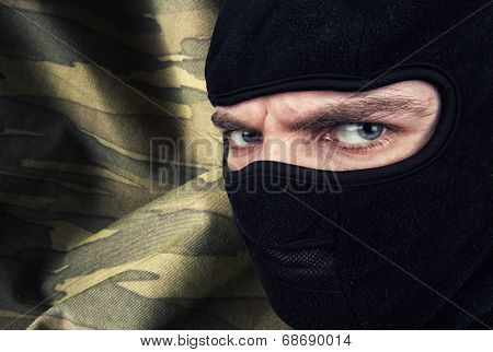 Serious man in a balaclava mask