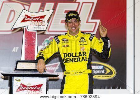 Daytona Beach, FL - Feb 20, 2014:  Matt Kenseth (20) wins the Budweiser Duel at Daytona International Speedway in Daytona Beach, FL.