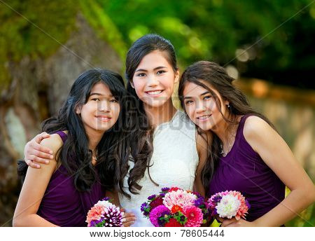 Bride With Her Two Bridesmaid Holding Bouquet Outdoors Together