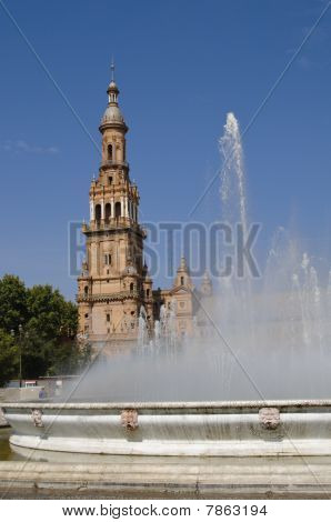 Plaza de Espana is one of the most visited tourist landmarks in Seville Spain. The main building was built for the Exposicion Iberoamericana that took place in year 1929. View of one of the towers and of the fountain in the center of the square. poster