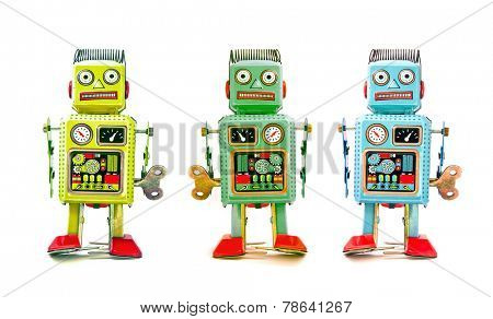 three robot toys in a line
