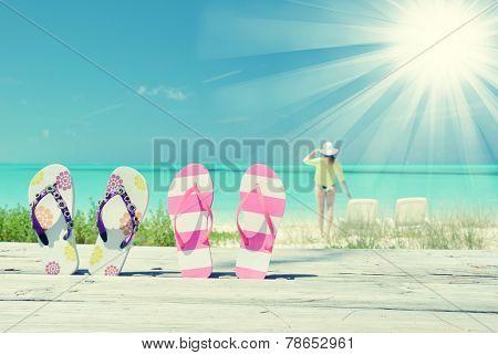 Flip-flops against ocean. Great Exuma island, Bahamas