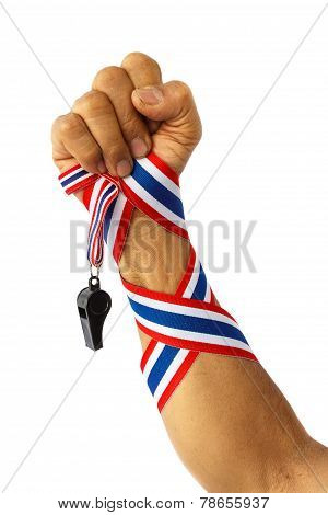 Forearm Of Thai Man With Ribbon And Whistle