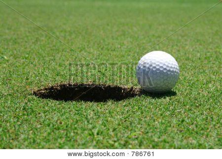 Golf hole & ball