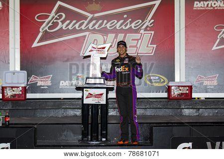 Daytona Beach, FL - Feb 20, 2014:  Denny Hamlin (11) wins the Budweiser Duel at Daytona International Speedway in Daytona Beach, FL.