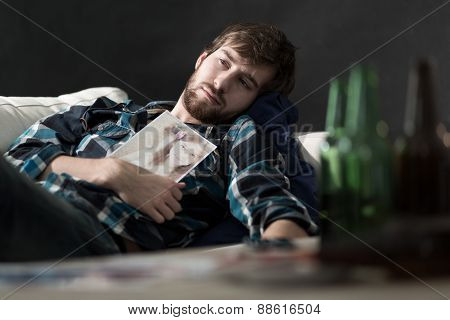 Depressed man drinking beers after split up poster