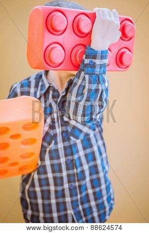 Boy  hiding behind the colores block. Close-up.