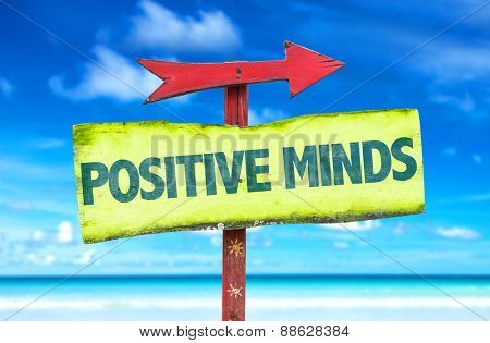 Positive Minds sign with beach background