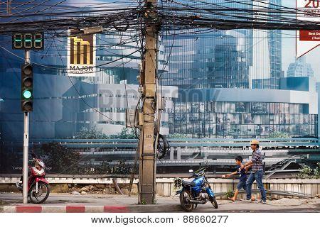 BANGKOK, THAILAND, FEBRUARY 25, 2015: Street scene in the Sukhumvit road near the Phrom Phong BTS station in Bangkok, Thailand