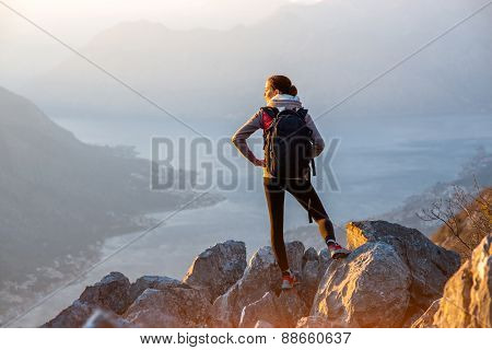 Young photographer on the top of mountain
