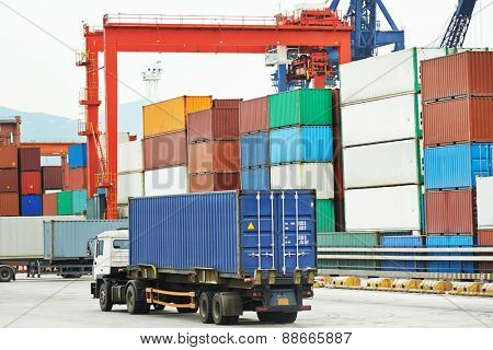 dock terminal of freight container boxes in open air cargo sea port warehouse