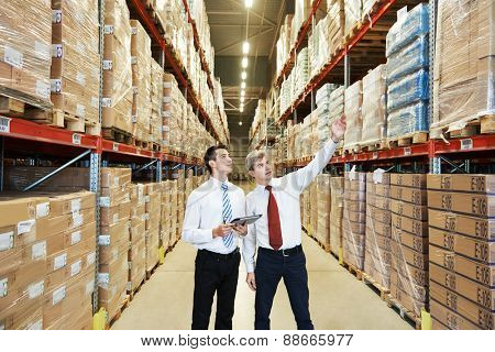 two managers workers in warehouse with bar code scanner