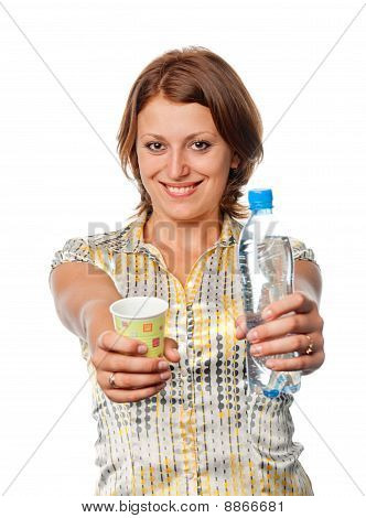 Girl Offers A Bottle Of Water And A Glass