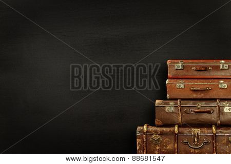Suitcases on black background