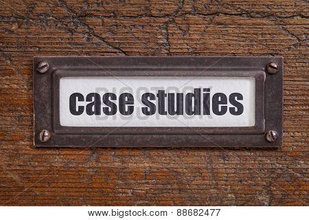 case studies  - file cabinet label, bronze holder against grunge and scratched wood