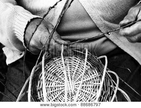 Laborious Hands Of Elder Craftsmen Create A Wicker Basket