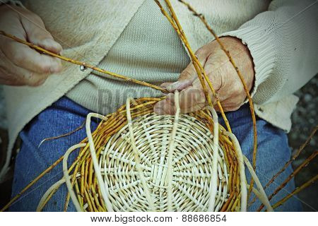 Elder Craftsmen Create A Woven Wicker Basket