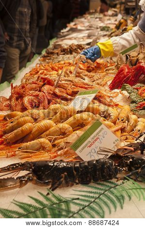 Fishmonger Stall With Fresh Seafood And Fish
