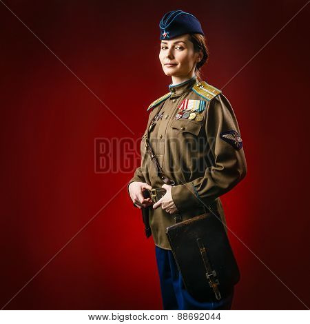 Historical reenactment of soviet union army by pretty woman in beautiful light on red background poster