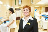 Portrait of hotel linen cleaning service manager poster