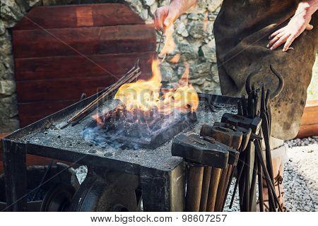 Artistic Blacksmith Works In The Historic Blacksmith Workshop